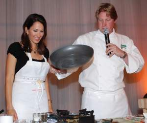 Chef Stephen Lewandowski with a volunteer sous chef on stage at the 2008 Interactive Dinner