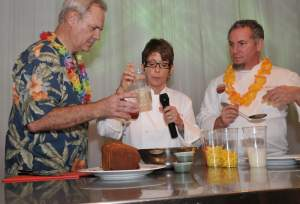 Chefs Hedy Goldsmith and Michael Schwartz give Festival Director Lyn Farmer his just desserts