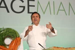 Chef Daniel Boulud guiding guests from stage at the Interactive Dinner in 2013